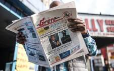 A man reads the Ethiopian newspaper 'The Reporter', depicting the portraits of killed Ambachew Mekonen (L), President of the Ahmara Region, and of Gen. Seare Mekonnen, Chief of Staff of the Ethiopian National Forces, in Addis Ababa, on 24 June 2019. Picture: AFP