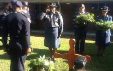 National Police Commissioner Riah Phiyega pays her respect to the murdered officers. Picture: Lauren Isaacs/EWN.