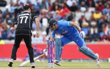 India's Mahendra Singh Dhoni is run out during the 2019 Cricket World Cup first semifinal between New Zealand and India at Old Trafford in Manchester, northwest England, on 10 July 2019. Picture: AFP