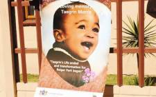 A photograph of Taegrin Morris is strung to a fence outside his home. Picture: Dineo Bendile/EWN.