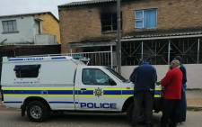 Officials outside a house in Apricot Street, Bonteheuwel, where a child after a fire in the home. Picture: Angus McKenzie/Supplied.