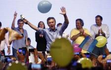 The Head of Government of the Autonomous City of Buenos Aires and candidate for the Cambiemos (Let's Change) party, Mauricio Macri (C), celebrates at the Cambiemos (Let's Change) party headquarters in Buenos Aires on 22 November, 2015, after getting early results of the presidential run-off election in Argentina. Picture: AFP.