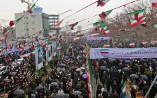 Iranians march during a ceremony celebrating the 40th anniversary of Islamic Revolution in the capital Tehran on 11 February 2019. Picture: AFP
