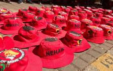 FILE: A vendor sells Nehawu hats. Picture: Christa Eybers/EWN