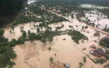 This handout photo taken on 25 July 2018 and released to AFP on 26 July by Mime Phousavanh shows an aerial view of the flooded area in Sanamxai, in Attapeu province after a dam collapsed on 23 July. Picture: AFP/courtesy of Mime Phoumsavanh.