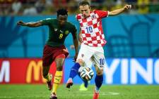 Cameroon midfielder Benjamin Moukandjo battles for the ball with Croatia midfielder Luka Modric. Picture: Facebook.com