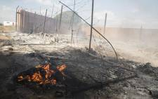 FILE: The remains of a house which was set alight during protests in Coligny in the North West over the death of a young boy. Picture: Reinart Toerien/EWN.