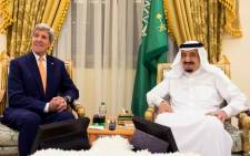 A picture provided by the Saudi Press Agency (SPA) on March 11, 2016 shows Saudi King Salman bin Abdulaziz (R) meeting with United States Secretary of State John Kerry in Hafar al-Batin 500 km north east of the Saudi capital Riyadh. Picture: AFP.