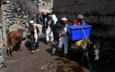 Villagers transport election materials on donkeys in the Dara-e-Noor district of Nangarhar province in Eastern Afghanistan on 4 April 2014. Picture: AFP/Noorullah Shirzada