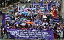 Activists from Gabriela march toward Malacanang palace to commemorate International Women's Day in Manila on 8 March 2019. Picture: AFP