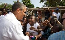 United States President Barack Obama greets young Senegalese children during his trip to Gorée Island. Pic: https://twitter.com/whitehouse