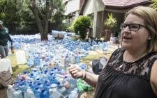 "Gauteng resident Kelly-Ann Van Der Meer founder of NGO ""One small act of kindness"" has collected 69 Tons for Cape Town animal shelters. Gift of the Givers will deliver the water in the coming days. Picture: IHSAAN HAFFEJEE/EWN"