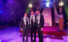 Joshua Broomberg (c) poses with his friends wearing Palestine scarf showing their support for Palestinians in Gaza. This picture caused an uproar of criticism and many people called for him to be removed from his leadership roles at the King David.
