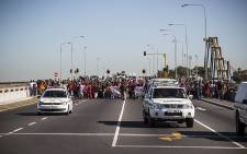 FILE: Nearly 1000 protesters make their way across the N1 at Century City towards the station on their way into town demanding their own land from the city. Picture: Thomas Holder/EWN