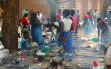 FILE: Women prepare food under the trees at a school in Bangula, Malawi. Picture: Aletta Harrison/EWN.