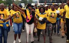 ANC supporters sing and dance as they enter the Mbombela Stadium in Mpumalanga ahead of the ANC 2014 election manifesto presentation. Picture: Reinart Toerien/EWN