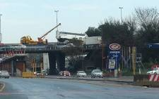 A bus spun out of control on the M1 North near Wits University on 9 August 2013 and nearly fell over the railing onto the road below. Picture: Gavin Donald/iWitness