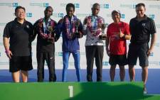 Joshua Kipkorir (centre), Felix Kirwa and Andrew Kimtai celebrate on the podium of the 2018 Singapore marathon. Picture: Standard Chartered Singapore Marathon/Facebook