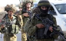 FILE: A file picture shows Israeli army during one of their raids in the southern West Bank on 12 June 2014. Picture: AFP.