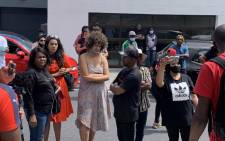 The group of queer artivists who have been occupying a mansion in Camps Bay handed over the keys to the property company on 8 October 2020. Picture: Kaylynn Palm/EWN