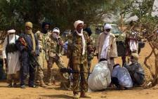 A picture taken on 13 July 2016 shows members of an armed group in Kidal, Mali. Picture: AFP.