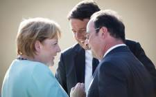 A handout picture released by Bundesregierung, the Cabinet of Germany (From L) shows German Chancellor Angela Merkel talks with Italian Prime Minister Matteo Renzi and French President Francois Hollande on the island of Ventotene on 22 August 2016. Picture: AFP.