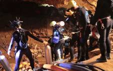 This undated handout photo taken recently and released by the Royal Thai Navy on 7 July 2018 shows a group of Thai Navy divers in Tham Luang cave during rescue operations for the 12 boys and their football team coach trapped in the cave at Khun Nam Nang Non Forest Park. Picture: AFP