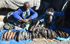 Indian Tea-tribe vendors sell cooked and uncooked rats at a weekly market in Kumarikata village along the Indo-Bhutan border, some 90km from Guwahati, on 23 December 2018. Picture: AFP