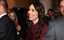 Labour Party leader Jacinda Ardern (C) arrives at the party's general election event at the Aotea Centre in Auckland on 23 September 2017. Picture: AFP.