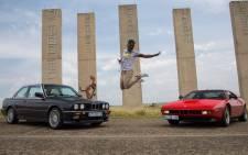 Jacob Moshokoa with the classic BMW vehicles.