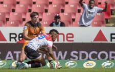 The Emirates Lions' Elton Jantjies scores a try during a Super Rugby match against Jaguares at the Emirates Airline Park Stadium, Johannesburg, on 9 March 2019.  Picture: AFP.