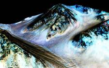 FILE. These dark, narrow, 100 metre-long streaks called recurring slope lineae flowing downhill on Mars are inferred to have been formed by contemporary flowing water. Picture: Nasa.