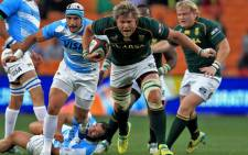 Springbok No 8 Duane Vermeulen is seen on attack against Argentina in their 73-13 victory over the South Americans at the Nelson Mandela Sport and Culture Day at FNB Stadium on Saturday, 17 August 2013. Picture: Sapa