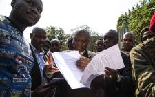 Joburg Mayor Herman Mashaba signs a memorandum brought by students in Braamfontein. Picture: Kayleen Morgan/EWN