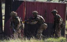FILE: Soldiers take up a position as they take part in a simulated military exercise of the British Army Training Unit in Kenya together with the Kenya Defence Forces (KDF) at the ol-Daiga ranch, high on Kenya's Laikipia plateau on 27 March 2018. Picture: AFP