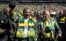 President Jacob Zuma and Deputy President Cyril Ramaphosa wave to the thousands of ANC supporters in the Emirates Airline Park in Johannesburg for the party's final rally ahead of the 2016 local government elections. Picture: Reinart Toerien/EWN