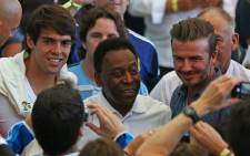 FILE: Fans take pictures of Brazil's Kaka, legend Pele and David Beckham at the Maracana Stadium just moement before the kickoff of the 2014 Fifa World Cup on 13 July 2014. Picture: Christa Eybers/EWN.
