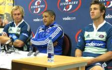 Stormers flyhalf Peter Grant (r), coach Allister Coetzee (c) and captain Schalk Burger (l) during a 2010 press conference. Picture: Aletta Gardner/EWN