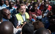 Kenya Airways's CEO Sebastian Mikosz (2nd L) speaks to media during a strike by the airline workers at the Jomo Kenyatta International Airport in Nairobi, Kenya, on 6 March 2019. Picture: AFP