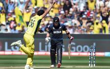 New Zealand captain Brendon McCullum (R) is bowled by Australia's Mitchell Starc (L) for a duck during the the 2015 Cricket World Cup final in Melbourne on March 29, 2015.  Picture: AFP