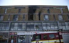 The blaze broke out at a block of flats along Voortrekker Road shortly after noon on Monday. Picture: Cindy Archillies/EWN
