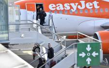Passengers board an EasyJet plane at the Nantes-Atlantique airport on 27 January 2018 in Bouguenais, outside Nantes, a week after the French government's official decision to abandon the Grand Ouest Airport project in Notre-Dame-des-Landes. Picture: AFP