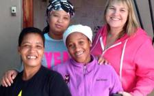 Ukama Holdings Founder Janine Roberts with some of the micro entrepreneurs she supports. Picture: Janine Roberts