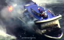 A photo grab taken from a video made available by the Guardia costiera, Italy's coast guard organisation on December 28, 2014, shows the burning ferry Norman Atlantic adrift off Albania. Picture: AFP.