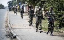 This file photo taken in July 2015 shows Burundian soldiers withdrawing from the restive Cibitoke neighbourhood in Bujumbura. Picture: AFP.