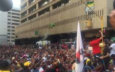 A huge crowd of students arrived at Luthuli House, chanting Fees Must Fall and booing ANC staff. Picture: Govan Whittles/EWN.