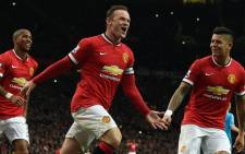 Manchester Uniteds English striker Wayne Rooney (C) celebrates scoring a penalty during during the English Premier League football match between Manchester United and Sunderland at Old Trafford in Manchester, north west England, on 28 February, 2015. Picture: AFP