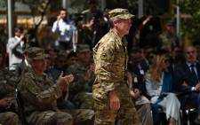 FILE: Incoming General Scott Miller (C), commander of US and Nato forces in Afghanistan walks during a change of command ceremony at Resolute Support in Kabul on 2 September 2018. Picture: AFP.