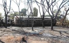 Burnt trees and the carcass of a burnt-out fuel tanker is seen along the side of the road following an explosion on 10 August 2019, in Morogoro, 200 kilometres (120 miles) west of the Tanzanian capital Dar es Salaam. Picture: AFP