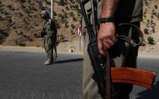 A member of the Kurdistan Workers Party (PKK) carries an automatic rifle on a road in the Qandil Mountains, the PKK headquarters in northern Iraq, on 22 June 2018. Picture: AFP.